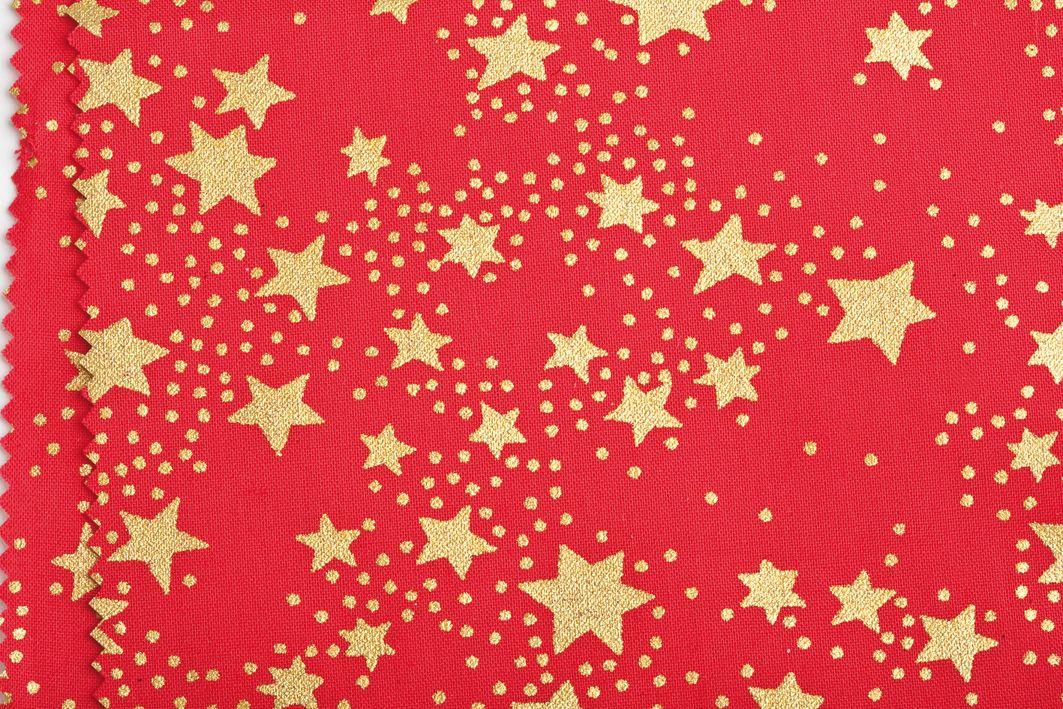 Weihnachtsstoff mit Sternendruck